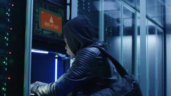 Black Man Hacking Computer System in Server Room