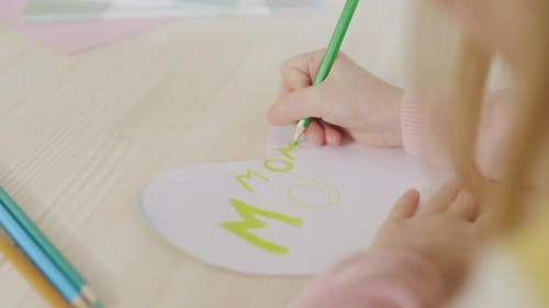 Child Drawing on Greeting Card