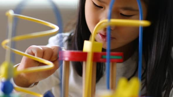 Thumbnail for Young Asian girl playing with toys