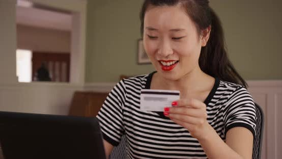 Thumbnail for Close view of millennial female shopper making online purchase with laptop pc