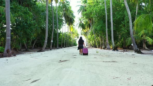 Thumbnail for Single female relaxing on tropical coast beach lifestyle by blue green lagoon and white sand backgro