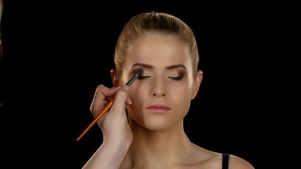 Thumbnail for Makeup Artist Makes Models Eye Makeup. Black. Closeup