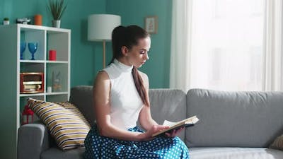Young Woman Is Reading at Home