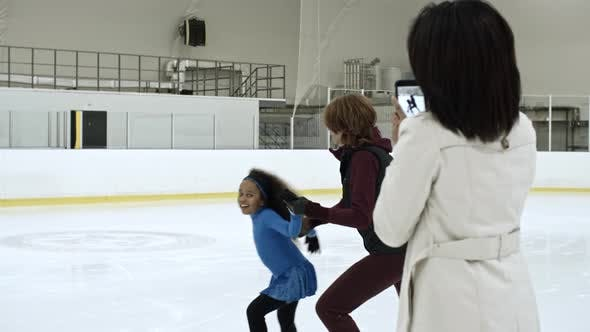 Cover Image for Woman Taking Picture of Daughter on Ice Rink