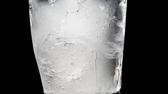 Ice Melts on a Black Background. Timelapse