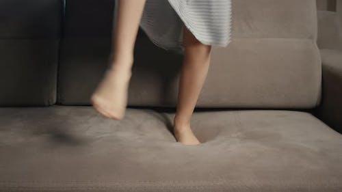 Jumping baby feet close up