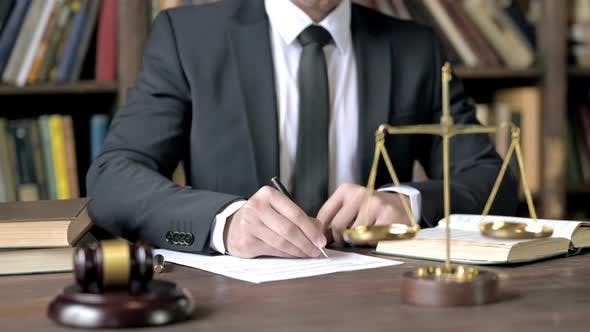 Thumbnail for Close Up Shoot of Judge Hand Signing Document in Court Room