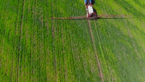 Following Tractor Sprayer in the Field.