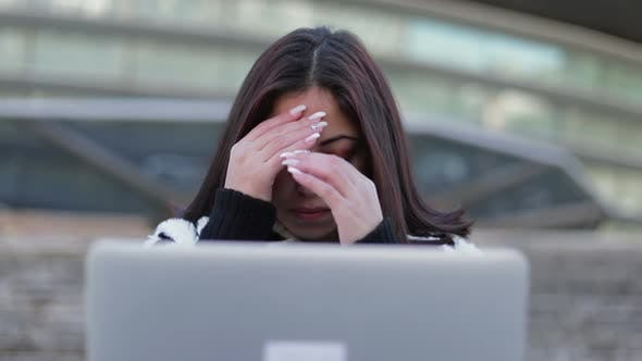 Thumbnail for Tired Beautiful Brunette Looking at Laptop and Rubbing Face