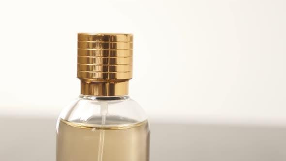 Thumbnail for Parfume  details with golden cap close-up slow tilt 4K 3840X2160 UHD video - Tilting on fragrance bo