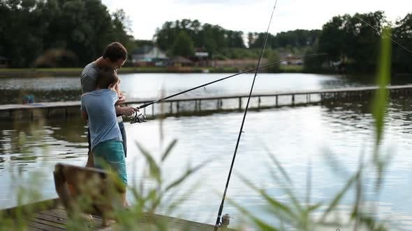 Thumbnail for Positive Dad and Son with Rod Angling at Pond