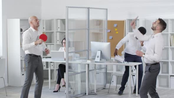 Thumbnail for Two Office Workers Enjoying Ping-Pong Break