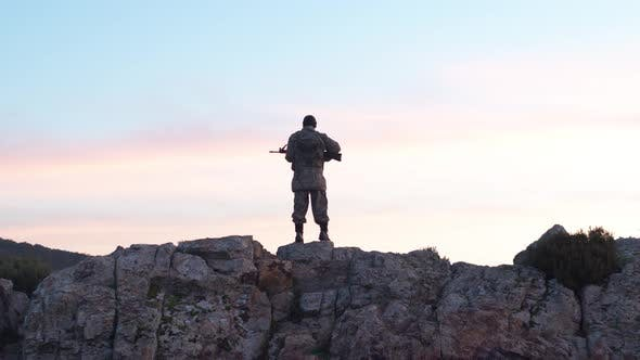 Cover Image for Soldier In The Morning Holds Guard With His Rifle