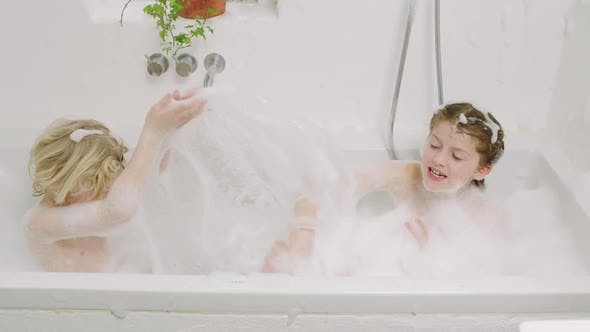Cover Image for Kids Splashing Water And Soap Suds From Bath
