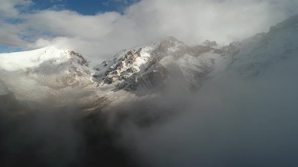 Thumbnail for Foggy Clouds In Winter Mountains