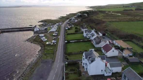 Aerial Tilt Up of Islay and Loch Indaal in Scotland