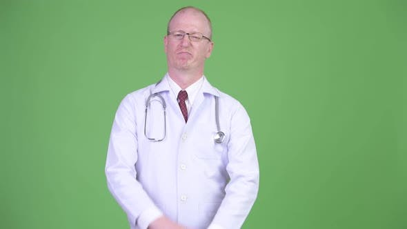 Thumbnail for Mature Bald Man Doctor Showing Stop Gesture with Both Arms