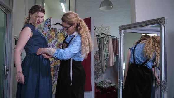 Thumbnail for Dressmaker Cutting Through Dress Pocket