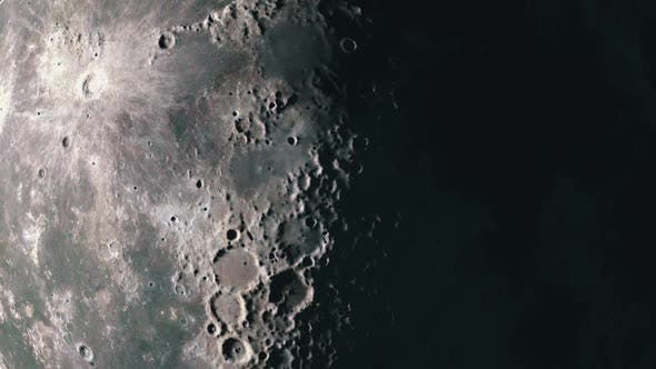 Thumbnail for Surface of The Moon as the Terminator Sweeps the Surface Highlighting the Craters