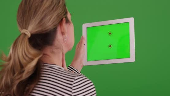 Thumbnail for Woman video calling white male doctor on tablet on green screen