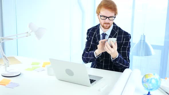 Thumbnail for Redhead Man Using Smartphone for Online Browsing, Designer