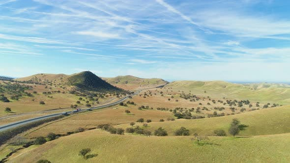 Thumbnail for Highway and Hilly Rural Landscape. Kern County. California, USA. Aerial View