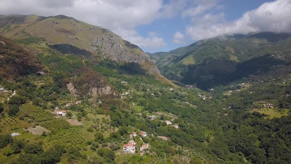 Cover Image for Aerial View of Mountain Gorge Hills Covered with Green Forest. Italian Landscape Sunny Weather