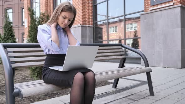 Thumbnail for Tired Young Woman Sitting Outside Office Working on Laptop