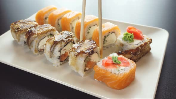 Sushi Rolls on a Plate. Acquaintance with Japanese Cuisine.