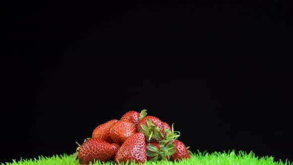 Thumbnail for Spinning Cadre of A Pile of Strawberries on A Black Background