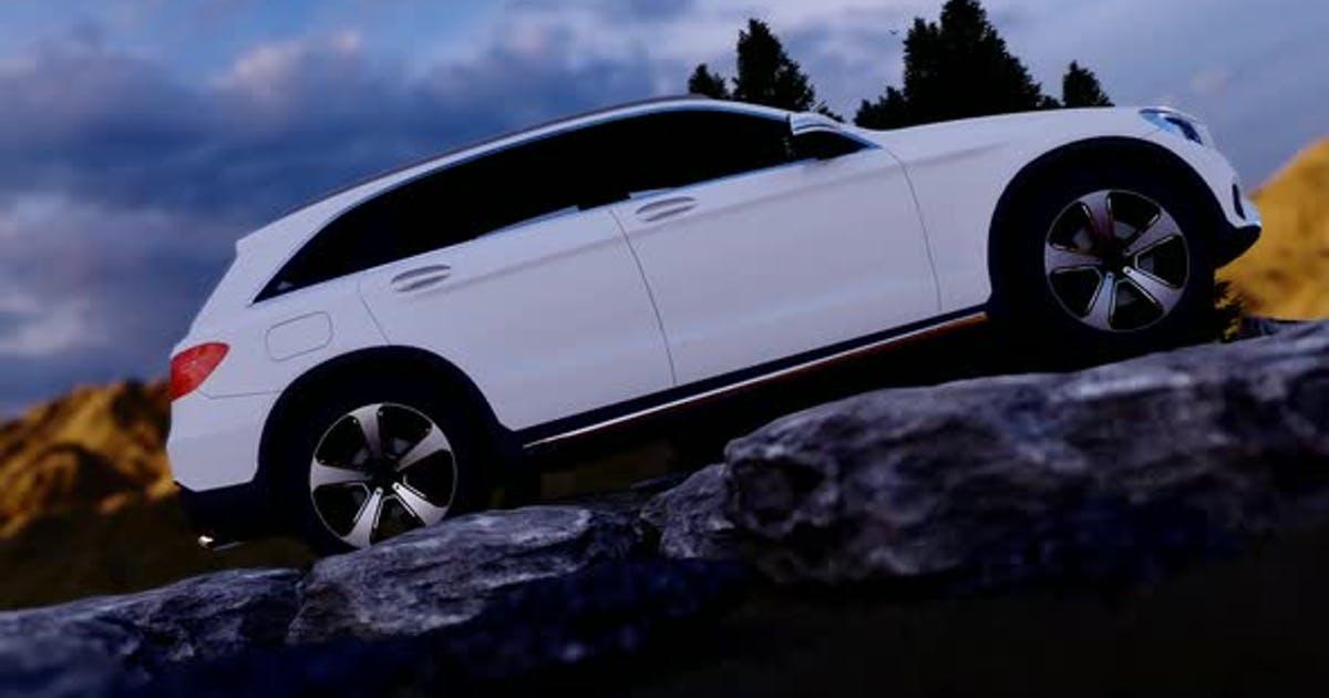 White Luxury Off-Road Vehicle Standing on Rocky Path in Mountainous Area with Sunset View