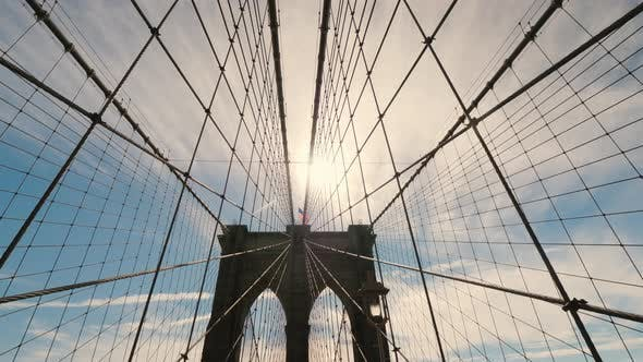 Cover Image for The Silhouette of the Pylons of the Brooklyn Bridge, a Lot of Ropes Hold the Canvas of the Bridge