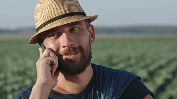 Cover Image for Modern Farmer Talking on Phone