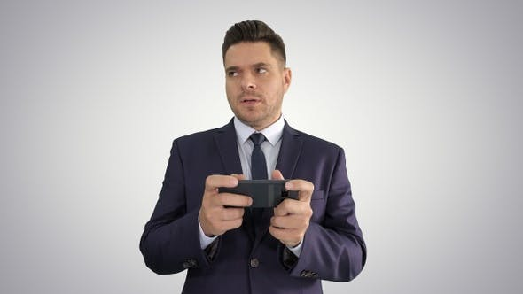 Thumbnail for Handsome Businessman Playing with His Smartphone and Losing