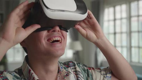 Man Explores Virtual Reality In Living Room
