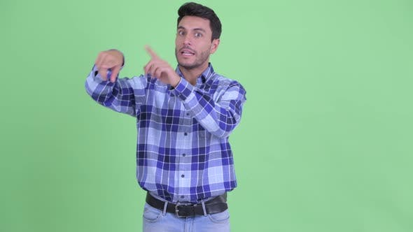 Thumbnail for Happy Young Handsome Hispanic Man Explaining Something