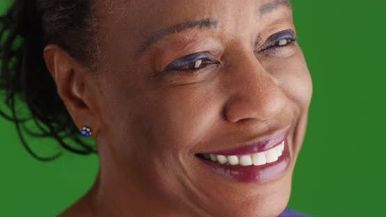 Thumbnail for A close-up of an elderly black woman looking into the distance on green screen