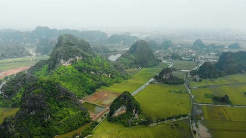 Aerial: North Vietnam karst landscape, drone view of Ninh Binh canyons and pinnacles