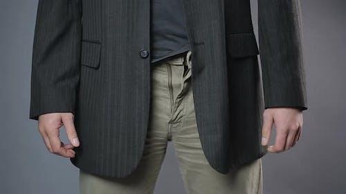 Slim Man Zipping and Unzipping Pants Zipper, Man's Clothes, Close-Up Shot