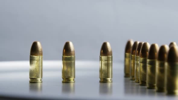 Cinematic rotating shot of bullets on a metallic surface - BULLETS 029