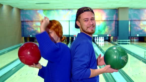 Thumbnail for Boy and Girl Dance with Bowling Balls