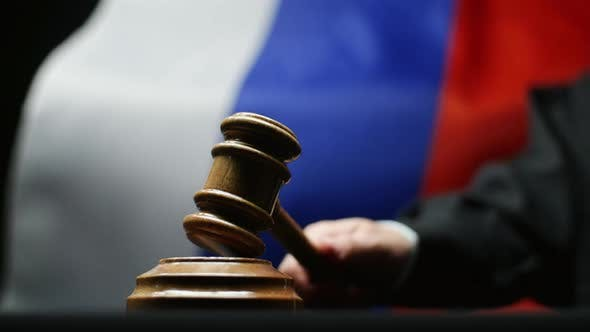 Thumbnail for Judge With Gavel In His Hand Hammering Against Waving Russian Flag Courtroom