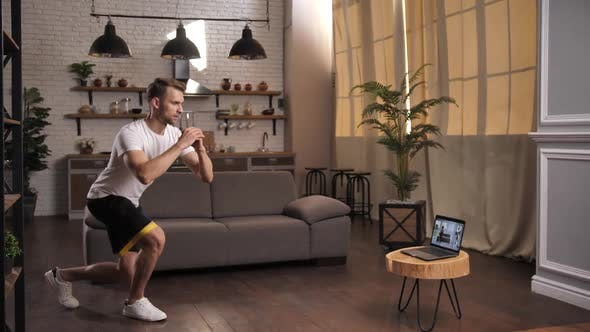 Young Sporty Male During Online Training at Home
