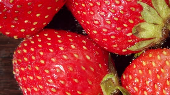 Thumbnail for Fresh Strawberries, Rotating Slowly. Macro Close Up. Rotate Top View