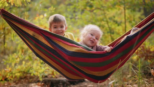 Little Boy and Girl Happy Lying in Hammock, Close-up