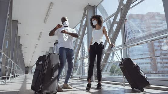 Afro American Young Couple, Husband and Wife, Brother and Sister Arrived at Airport, Stand with