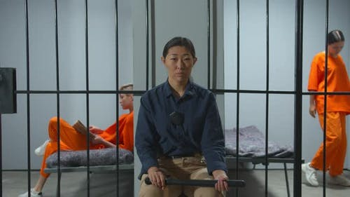Female Security Guard on Duty in Prison. View