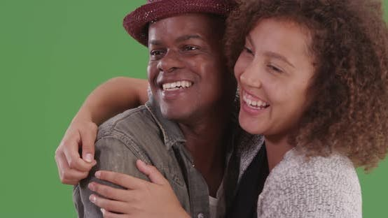 Thumbnail for Young black man and woman hugging on green screen