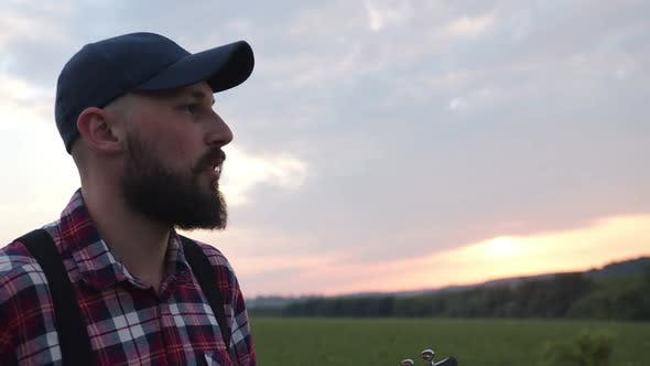Caucasian Man Sings Song in the Countryside