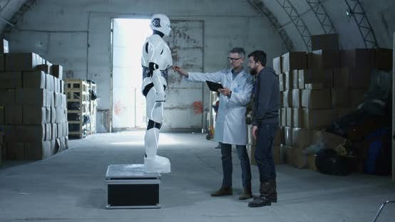 Thumbnail for Engineers Testing Robot in a Warehouse